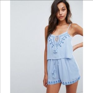 Missguided blue embroidered romper size 4